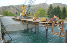 Installation the temporary trestle or work bridge has commenced, from which Bridge 2 on the Hakataramea side of the Waitaki River will be constructed..