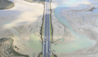The causeway upgrade will widen and raise the Northwestern Motorway to add capacity and prevent flooding.