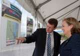 Parker shows Hon Judith Collins the Western Ring Route RoNS project on paper.